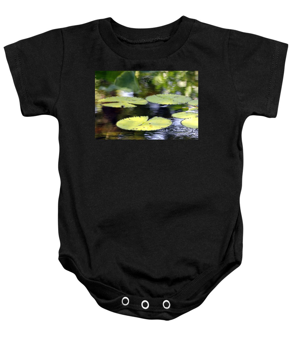 Pad Baby Onesie featuring the photograph Padded Ripplies by Alycia Christine