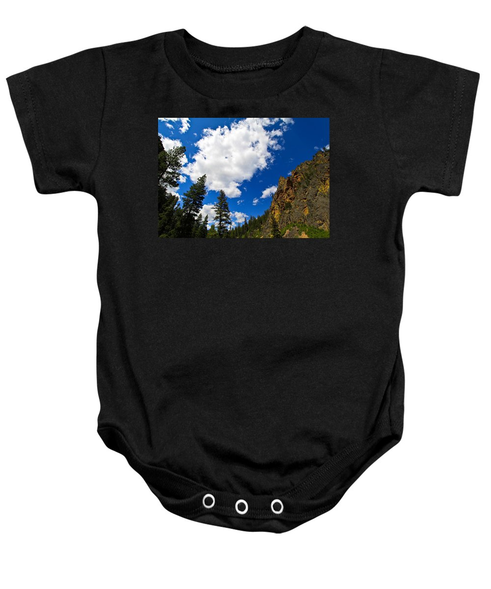 Lake Baby Onesie featuring the photograph Painted Rocks by Steve McKinzie