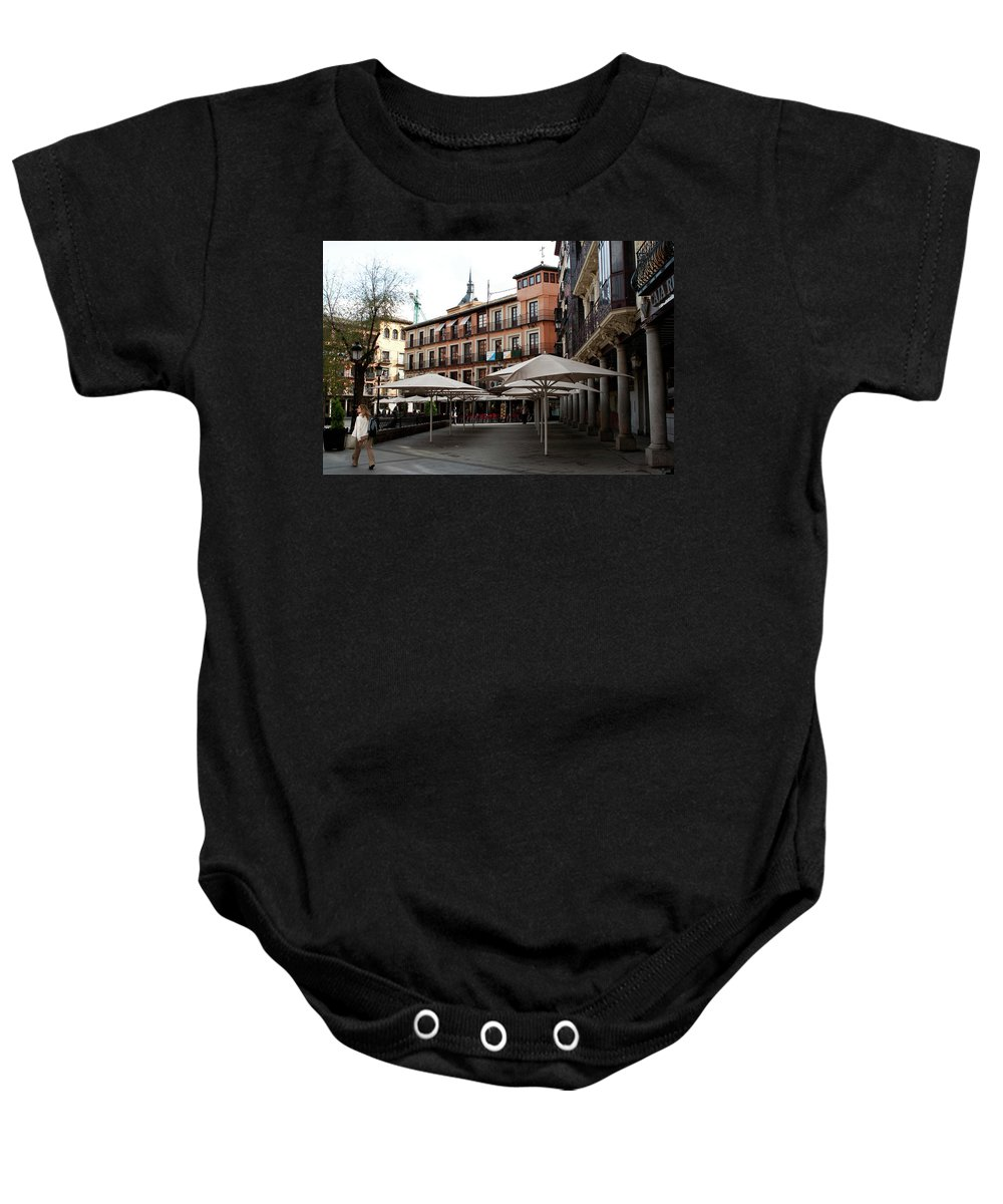 Toledo Baby Onesie featuring the photograph Passing By Zocodover Square by Lorraine Devon Wilke