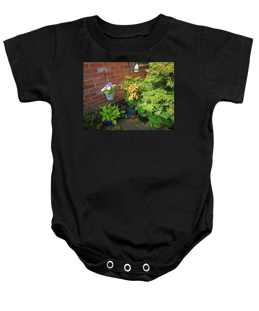 Garden Baby Onesie featuring the photograph Petunias by Charles Stuart