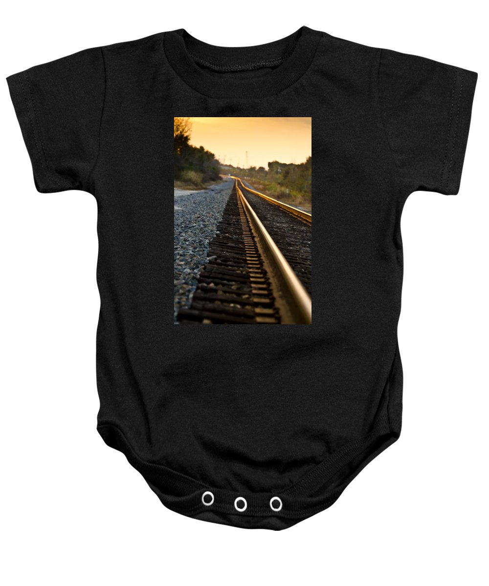Train Baby Onesie featuring the photograph Railroad Tracks At Sundown by Carolyn Marshall