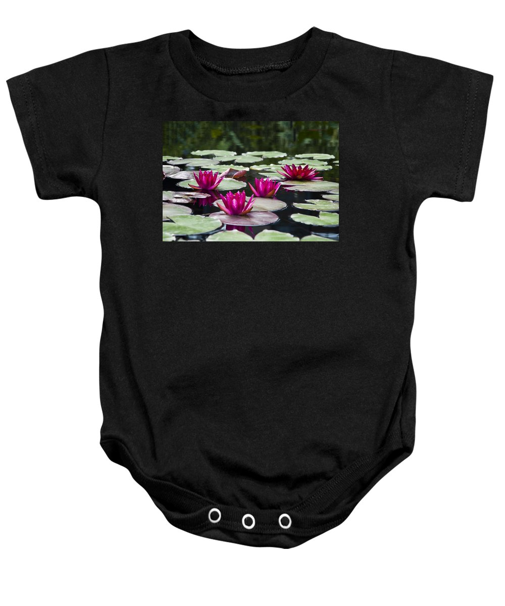 Red Water Lillies Baby Onesie featuring the photograph Red Water Lillies by Bill Cannon