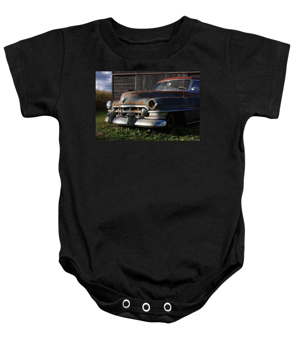 Cadillac Baby Onesie featuring the photograph Retired by Lyle Hatch