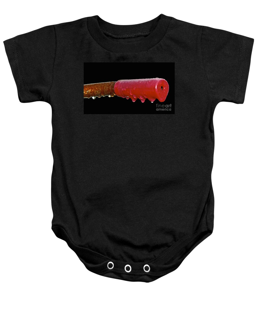 Rust Baby Onesie featuring the photograph Ride In The Rain by Gwyn Newcombe