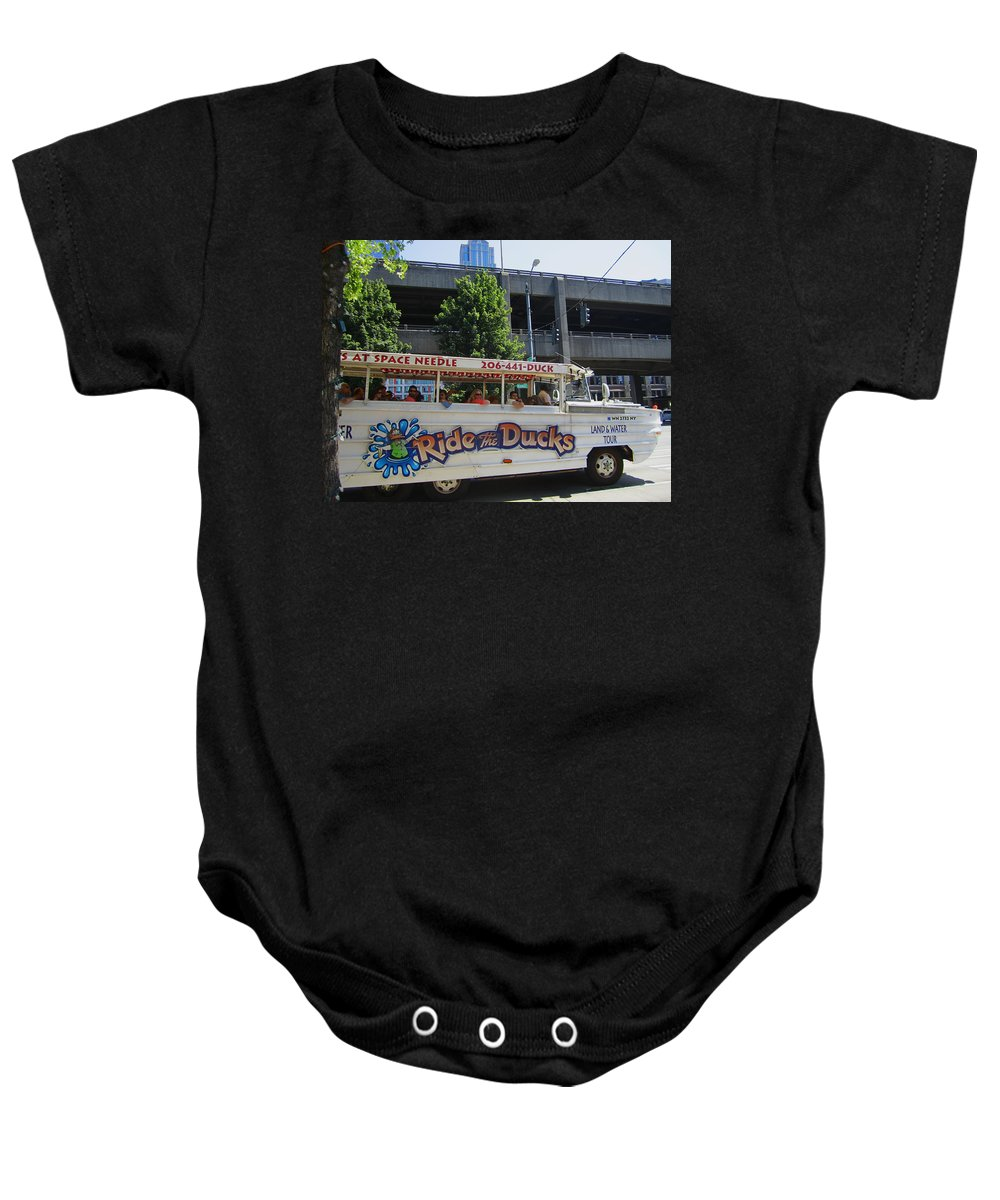 Ride The Ducks Baby Onesie featuring the photograph Ride The Ducks by Kym Backland