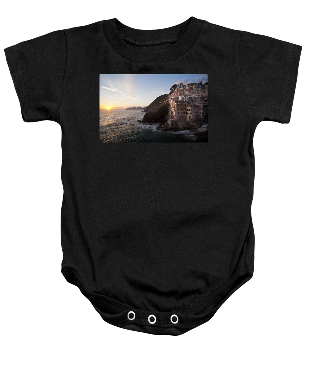 Riomaggio Baby Onesie featuring the photograph Riomaggio Sunset by Mike Reid