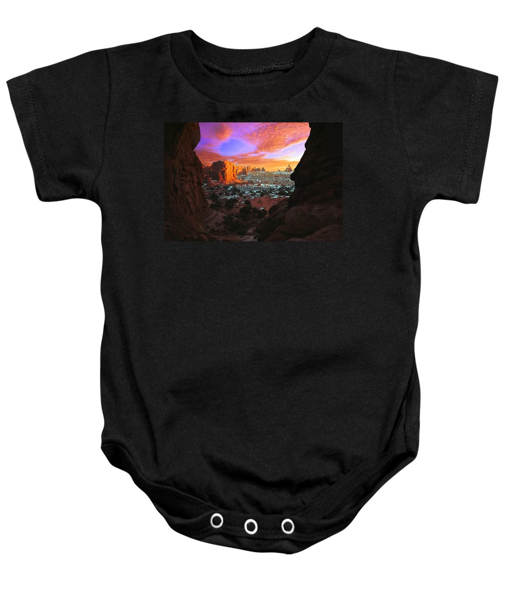 Bluff Baby Onesie featuring the photograph Rocky Buttes Viewed Through Canyon by Corey Hochachka