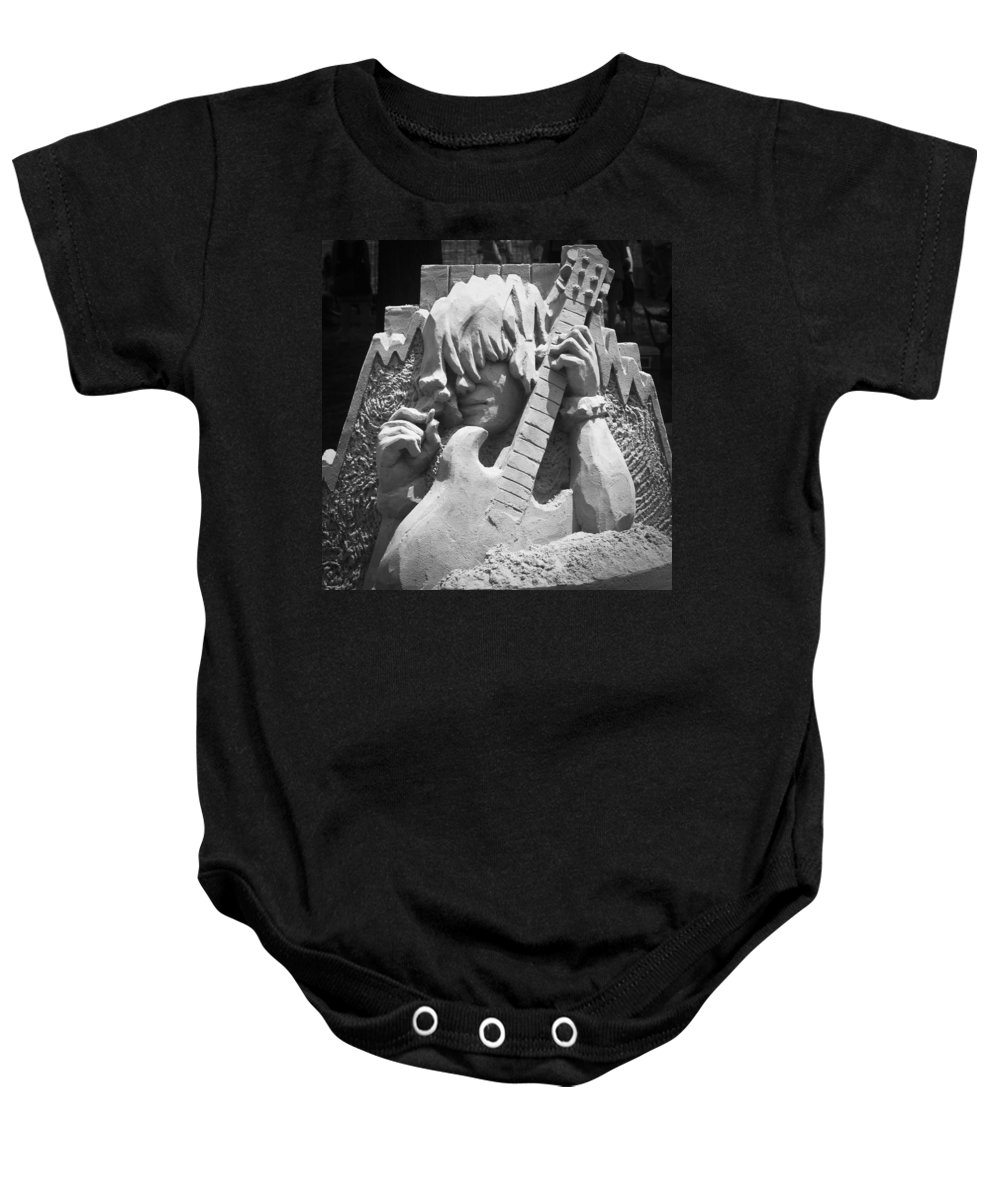 Sand Sculpture Baby Onesie featuring the photograph Sandy Rock Musician by Teresa Mucha