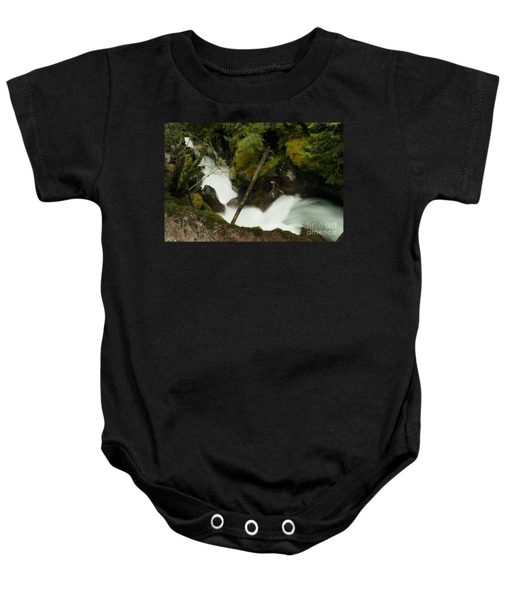 Water Baby Onesie featuring the photograph Smoothing The Rocks by Jeff Swan