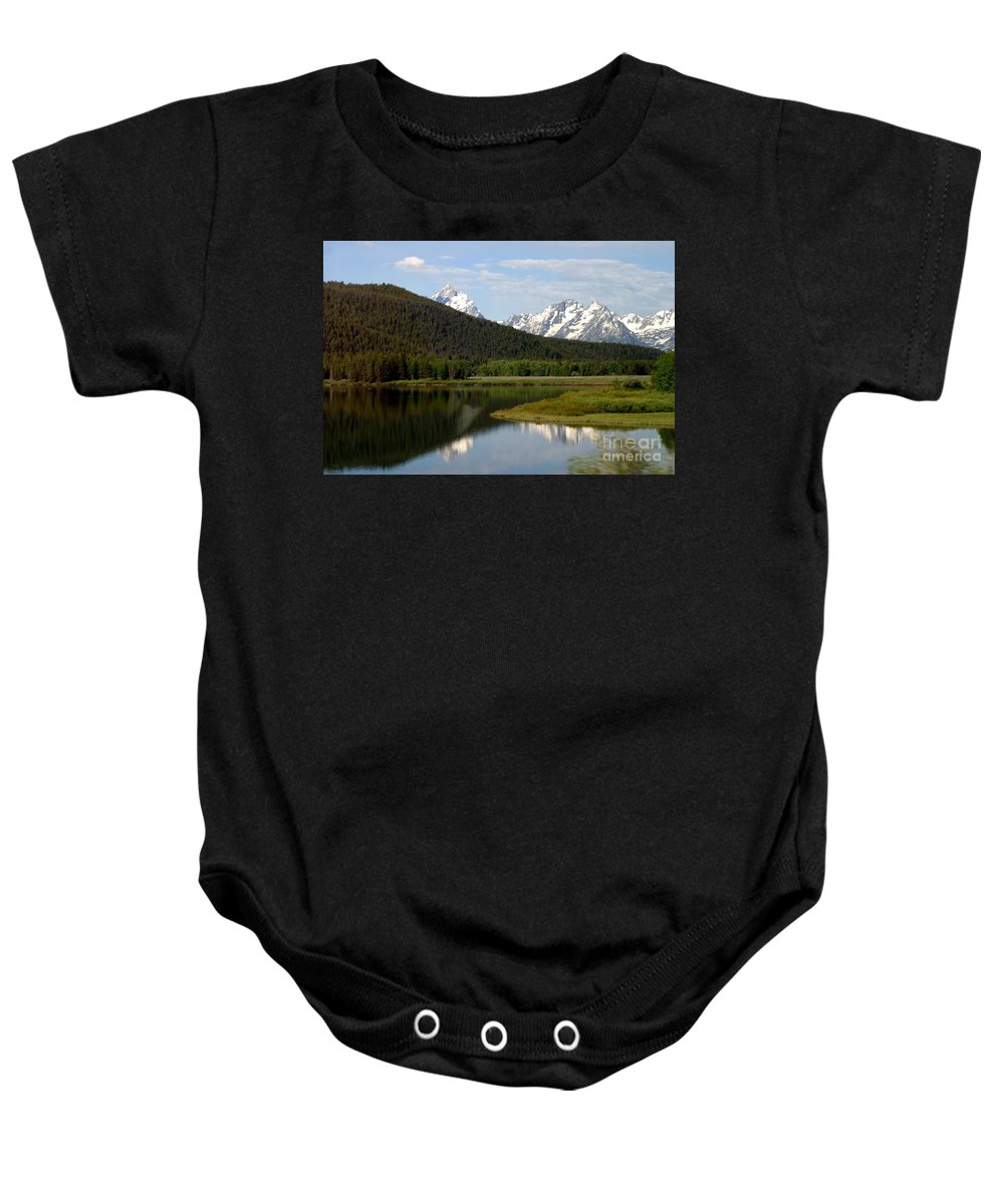 Grand Tetons Baby Onesie featuring the photograph Still Waters by Living Color Photography Lorraine Lynch