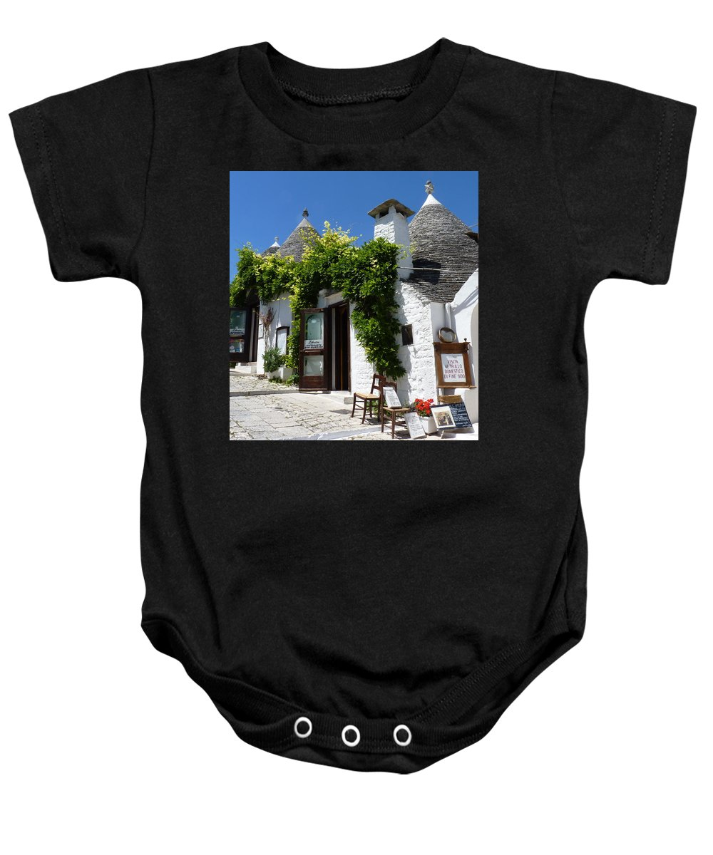 Alberobello Baby Onesie featuring the photograph Street Scene In Alberobello by Carla Parris