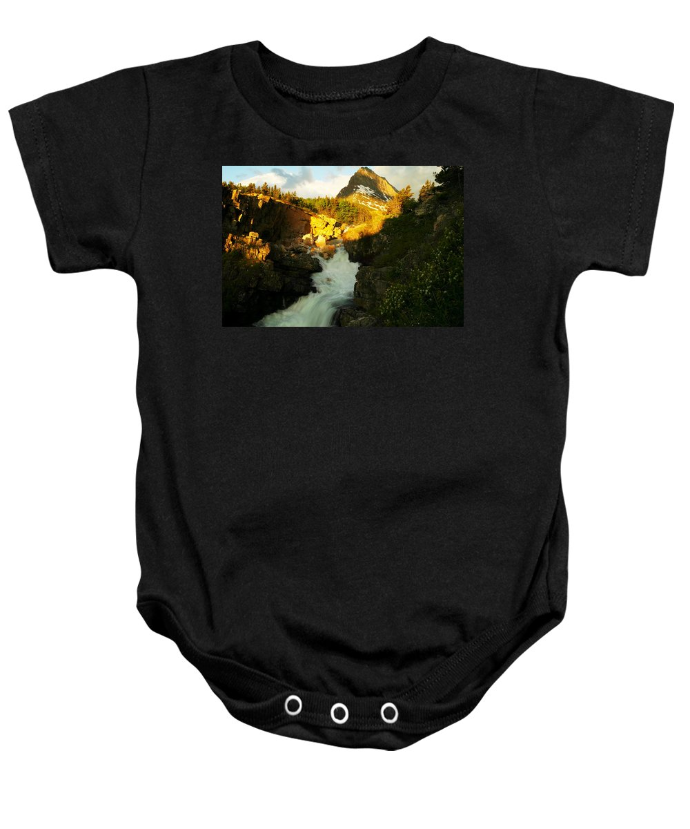 Mountains Baby Onesie featuring the photograph Sunrise On A Waterfall At Glacier by Jeff Swan
