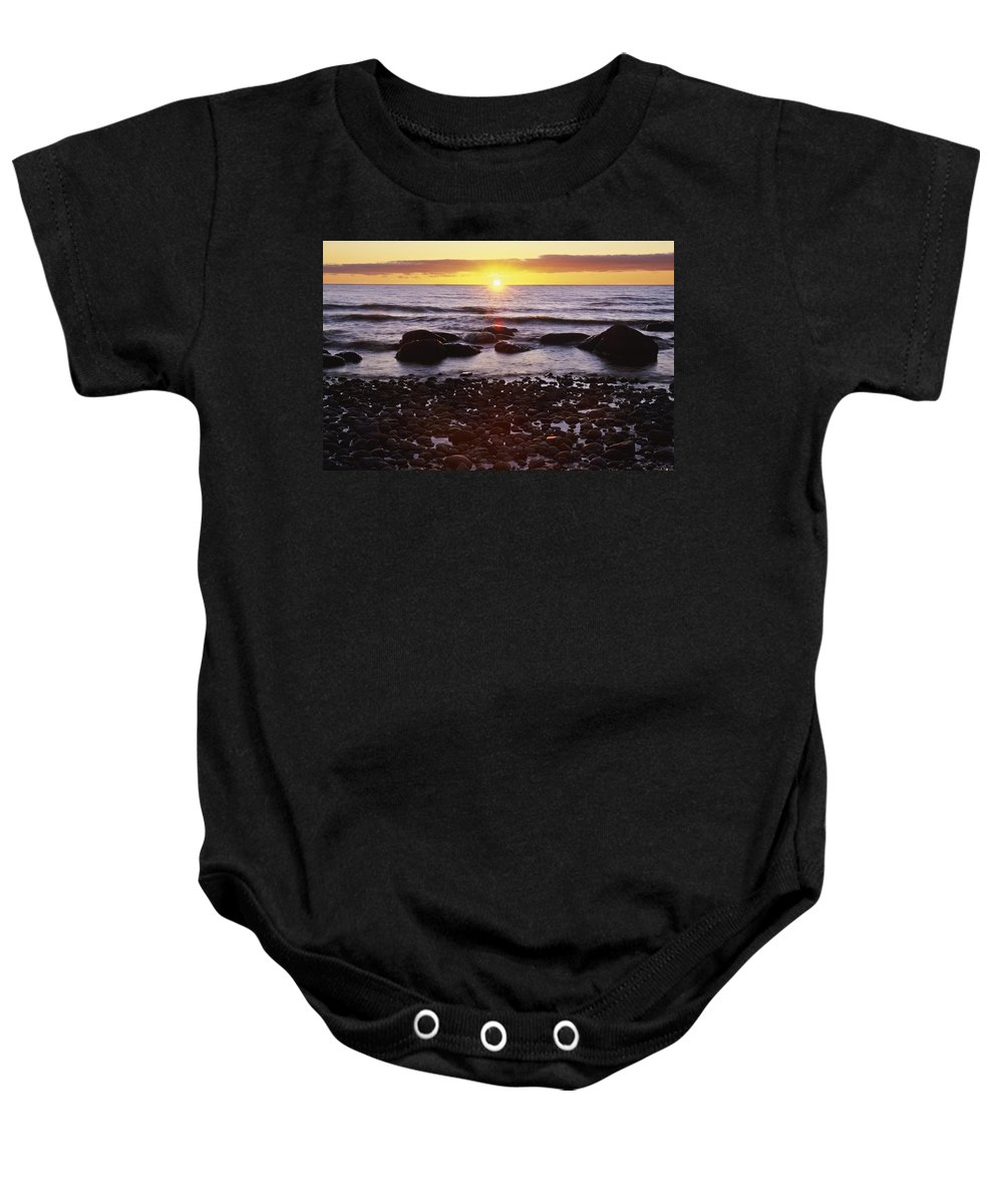Clouds Baby Onesie featuring the photograph Sunset Over Water, Newfoundland, Canada by Bilderbuch