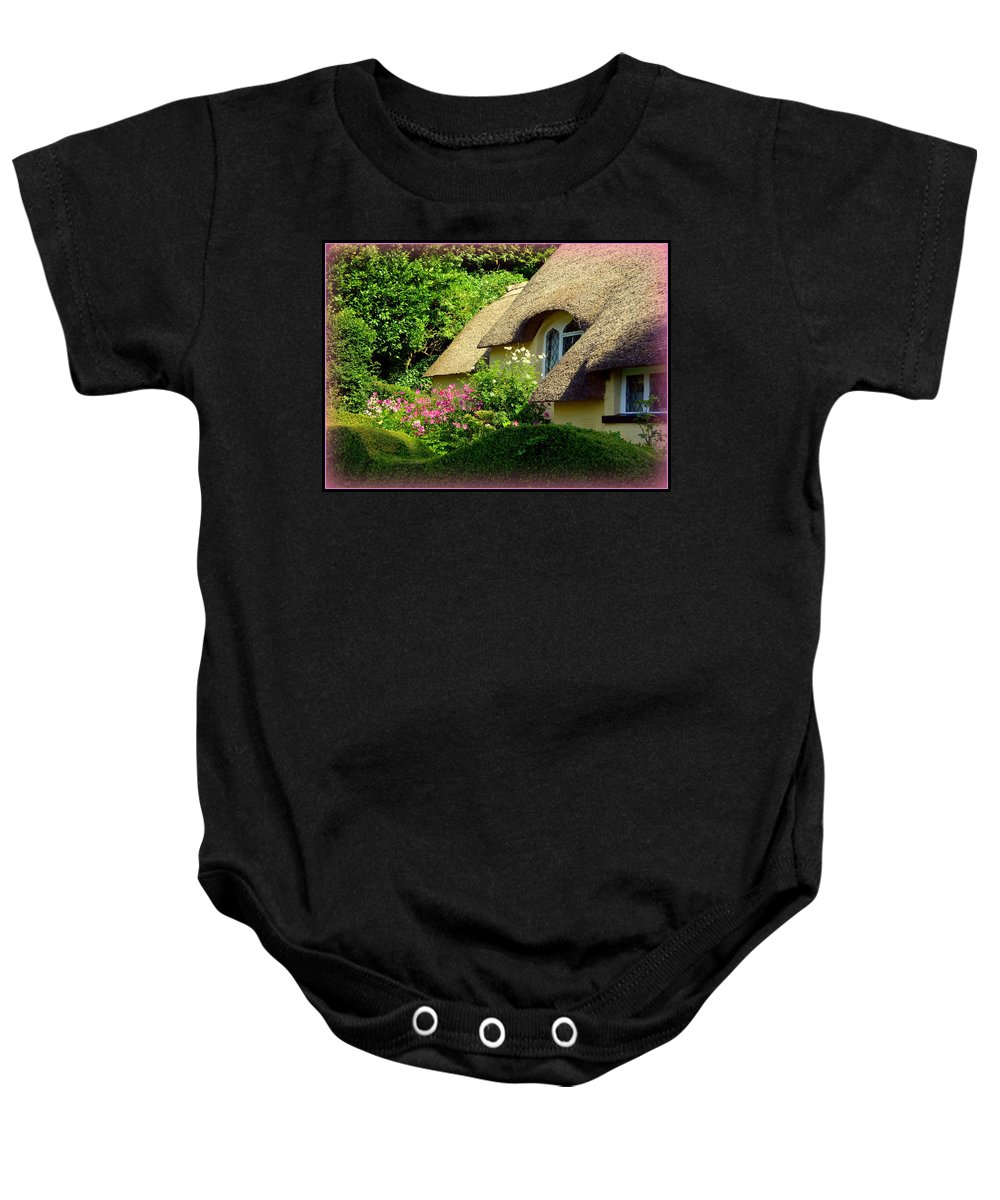 Selworthy Baby Onesie featuring the photograph Thatched Cottage With Pink Flowers by Carla Parris