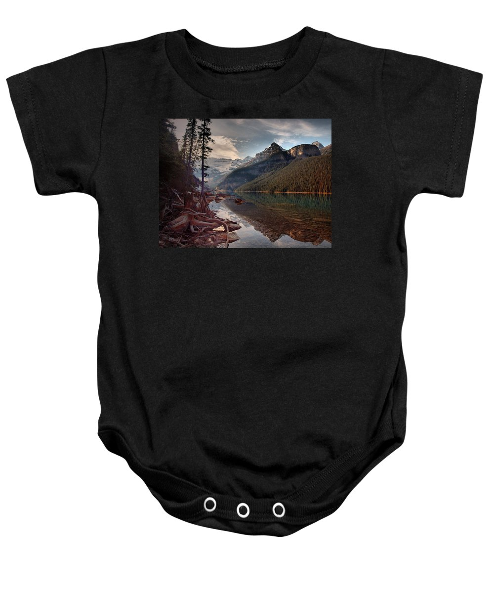 Mountains Baby Onesie featuring the photograph The Calm At Lake Louise by Tara Turner