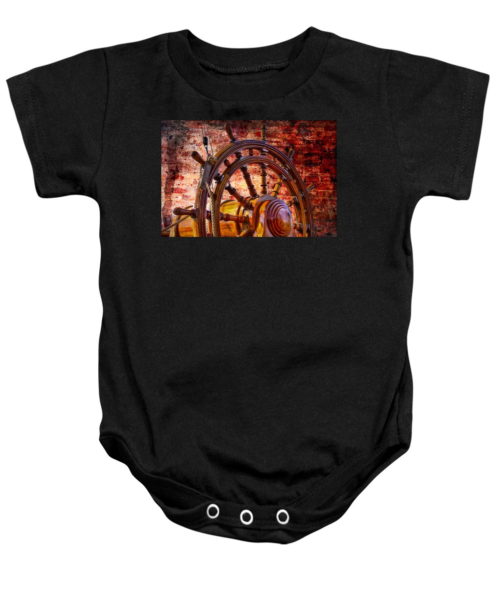 Boats Baby Onesie featuring the photograph The Helm by Debra and Dave Vanderlaan