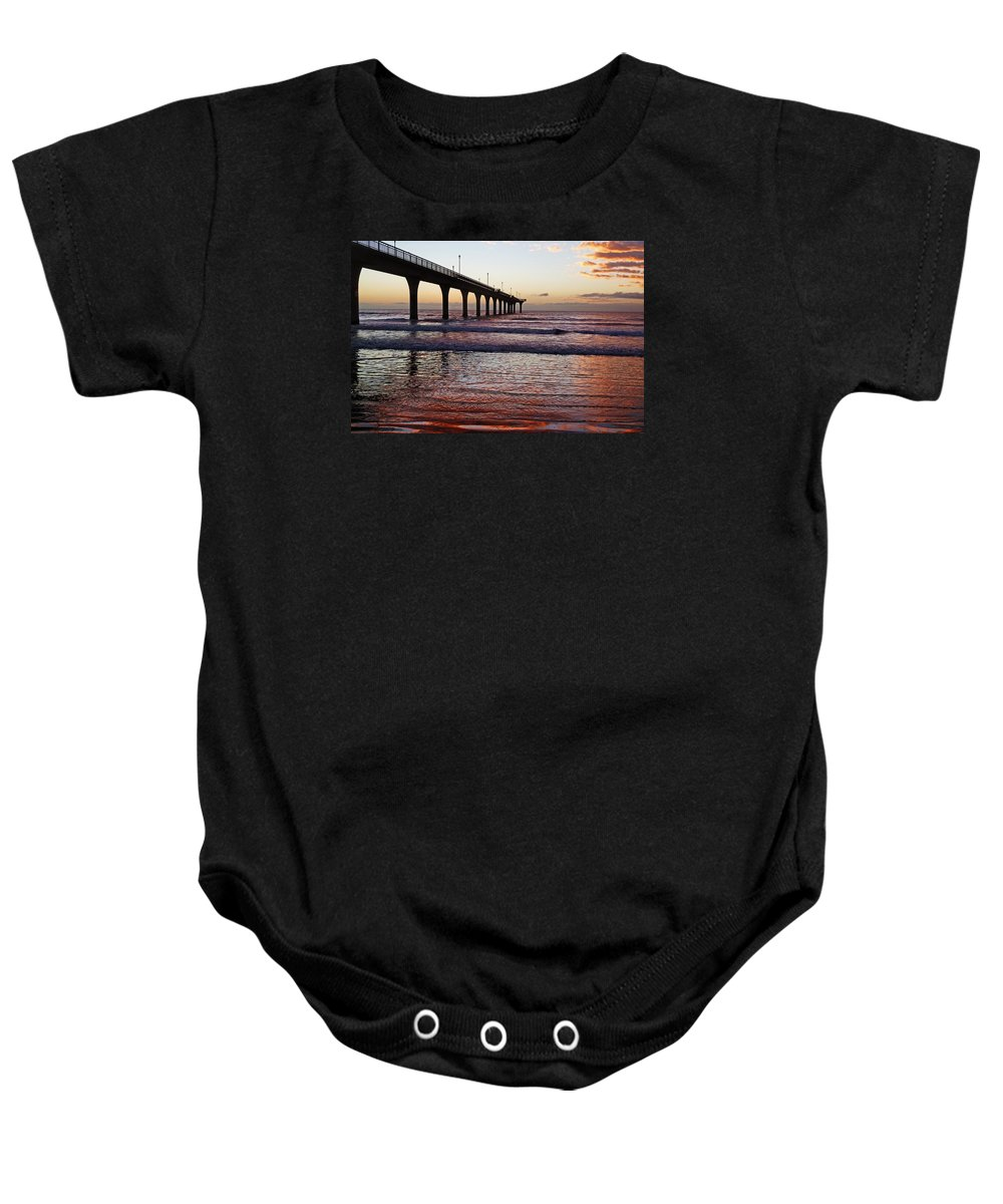 New Brighton Baby Onesie featuring the photograph The Red Dawn by Steve Taylor
