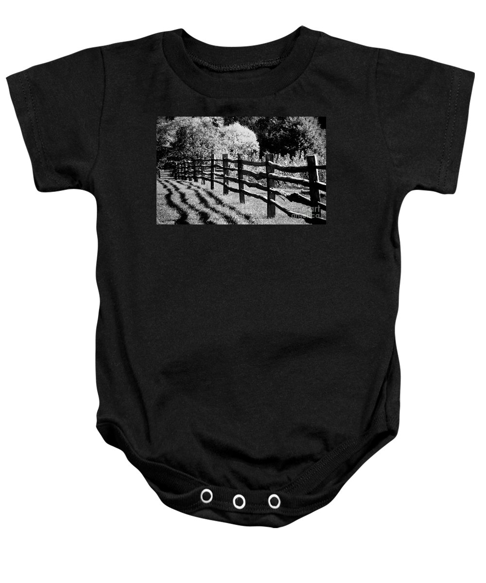 Fence Baby Onesie featuring the photograph The Wooden Fence by Mike Nellums