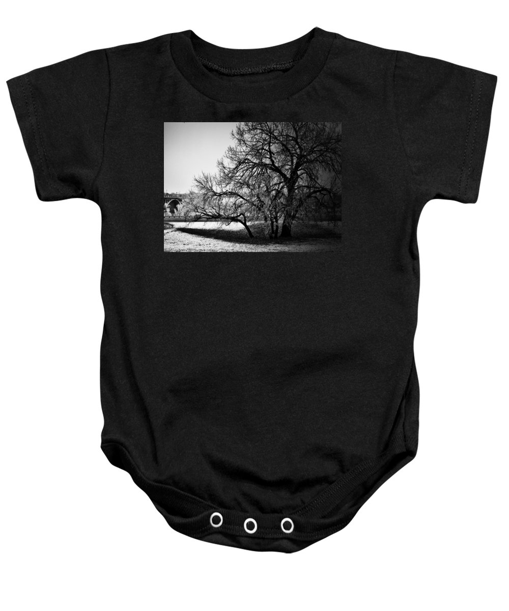Black And White World Photographer Baby Onesie featuring the photograph Under The Waiting Tree by The Artist Project