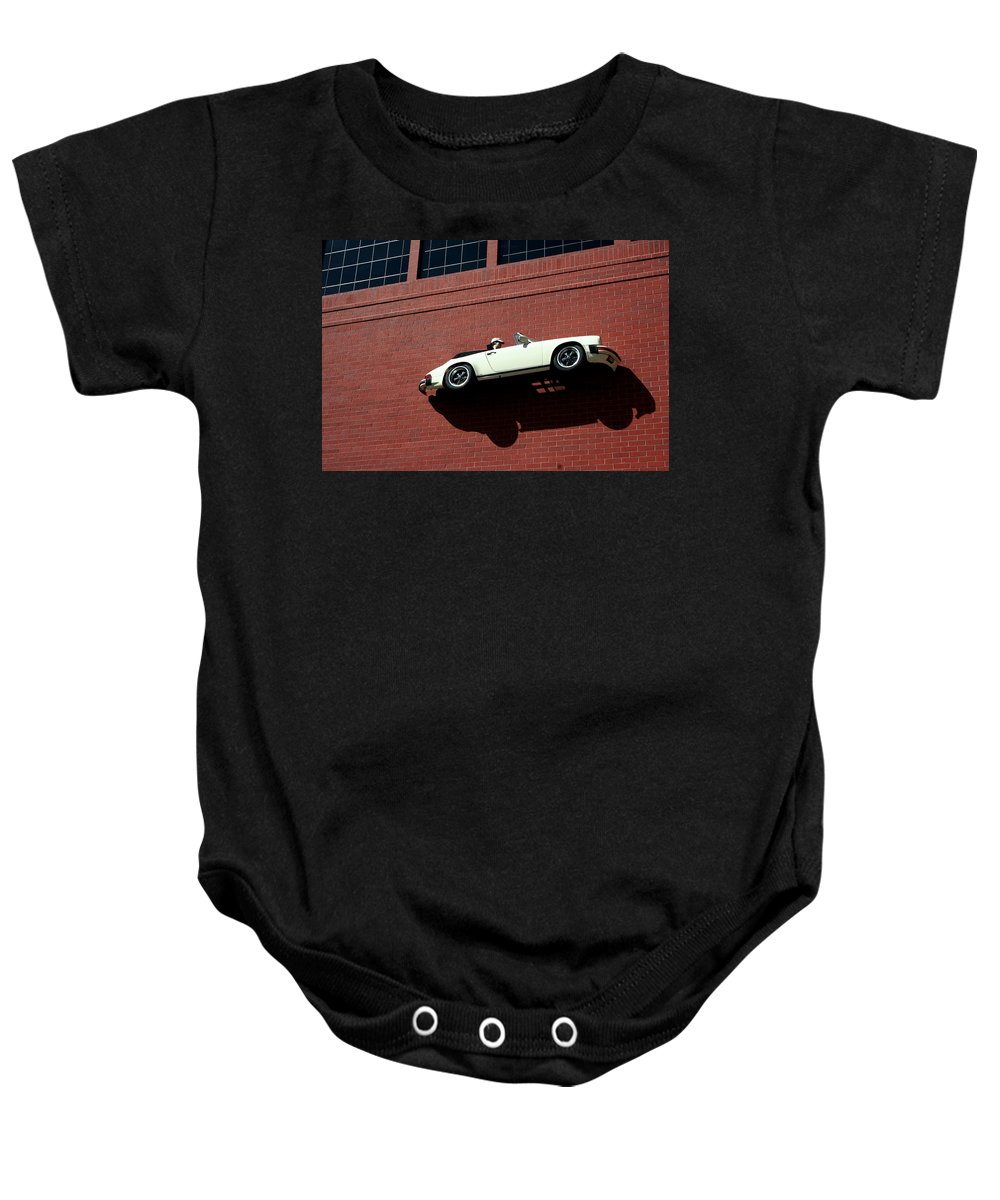 Brick Baby Onesie featuring the photograph Vroom by Ric Bascobert