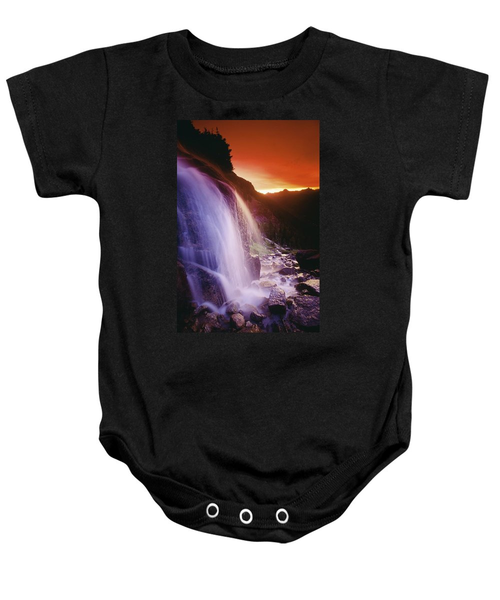 British Columbian Baby Onesie featuring the photograph Waterfall At Sunset, Bugaboo Glacier by Bilderbuch