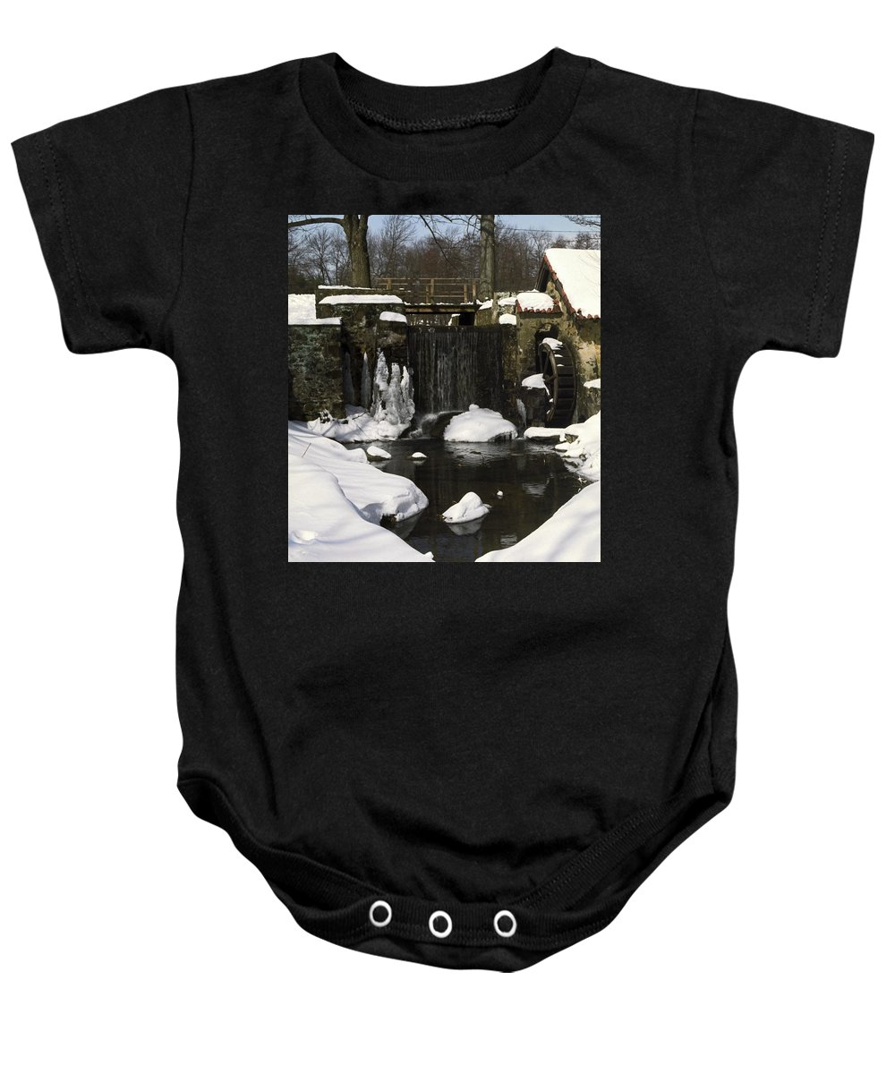 Stream Baby Onesie featuring the photograph Waterwheel And Stream In Winter by Sally Weigand