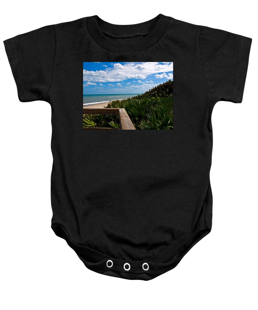 Beach; February; Florida; Warm; Warmth; Temperature; Degrees; Weather; Sun; Melbourne; Sand; Shore; Baby Onesie featuring the photograph Melbourne Beach On The East Coast Of Florida by Allan Hughes