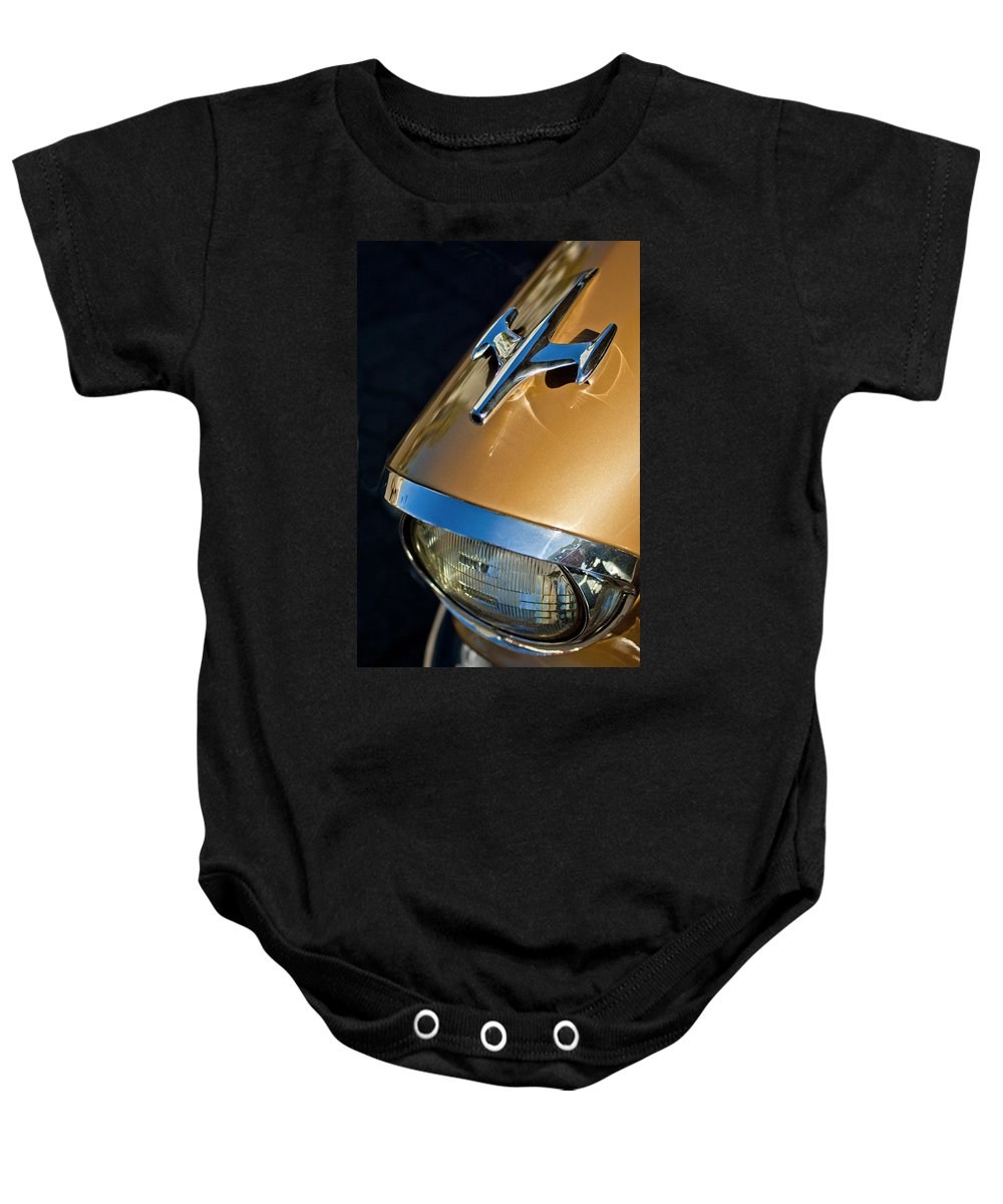 1957 Oldsmobile Super 88 Baby Onesie featuring the photograph 1957 Oldsmobile Super 88 Hood Ornament by Jill Reger