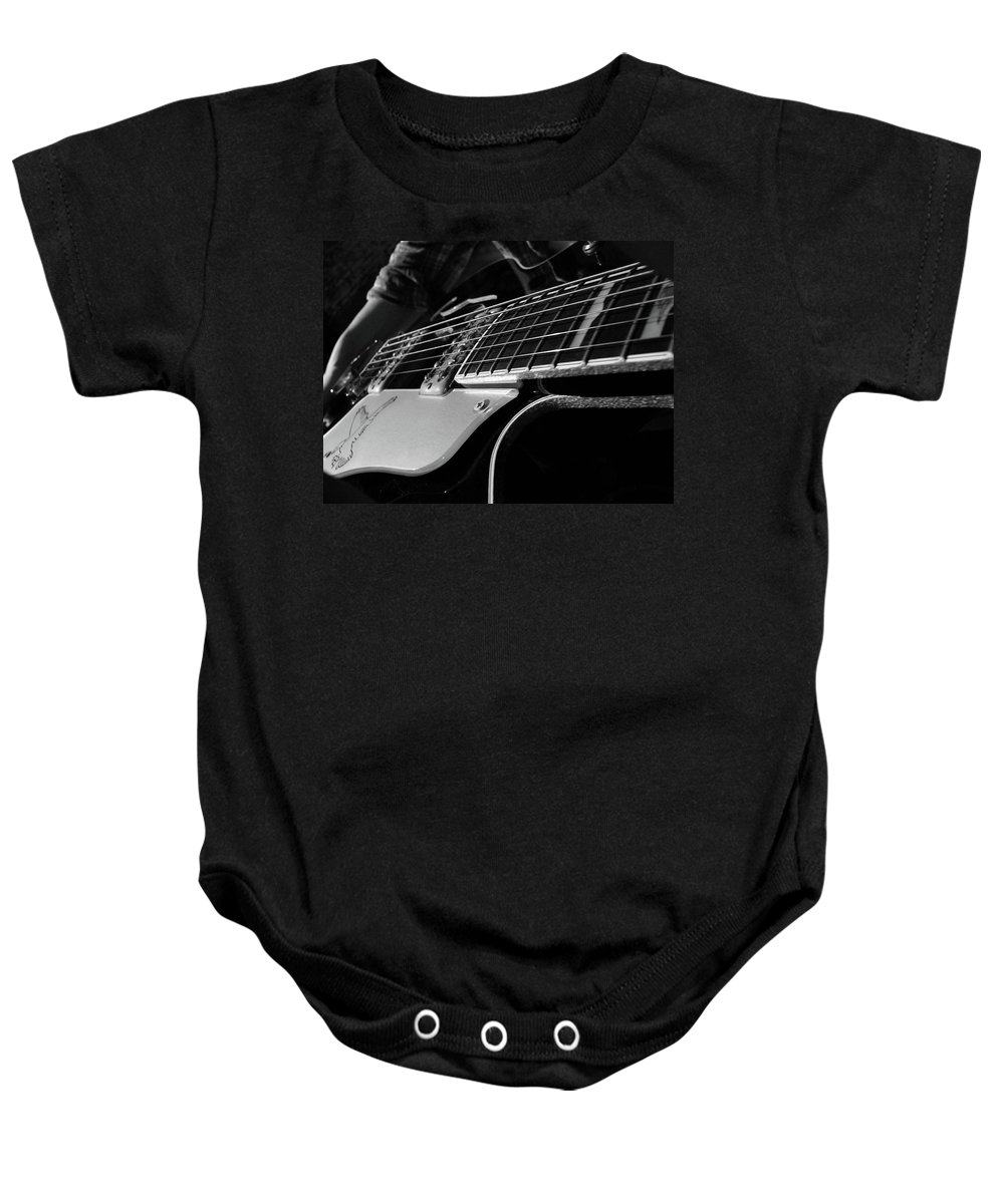 Black Baby Onesie featuring the photograph Strings by Angela Wright