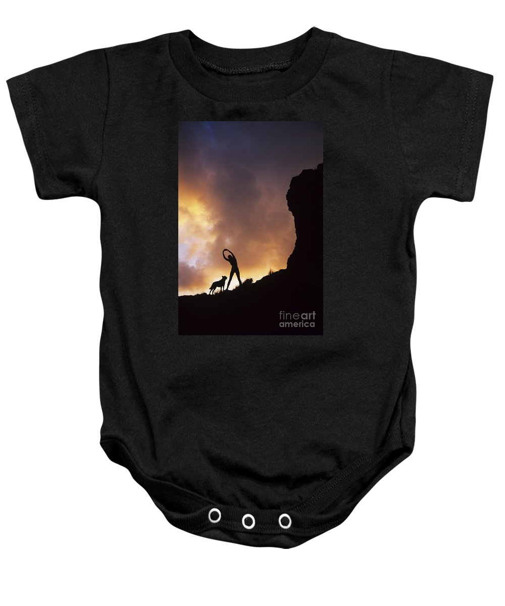 Amazing Baby Onesie featuring the photograph Woman Stretching On A Mountain by Dana Edmunds - Printscapes