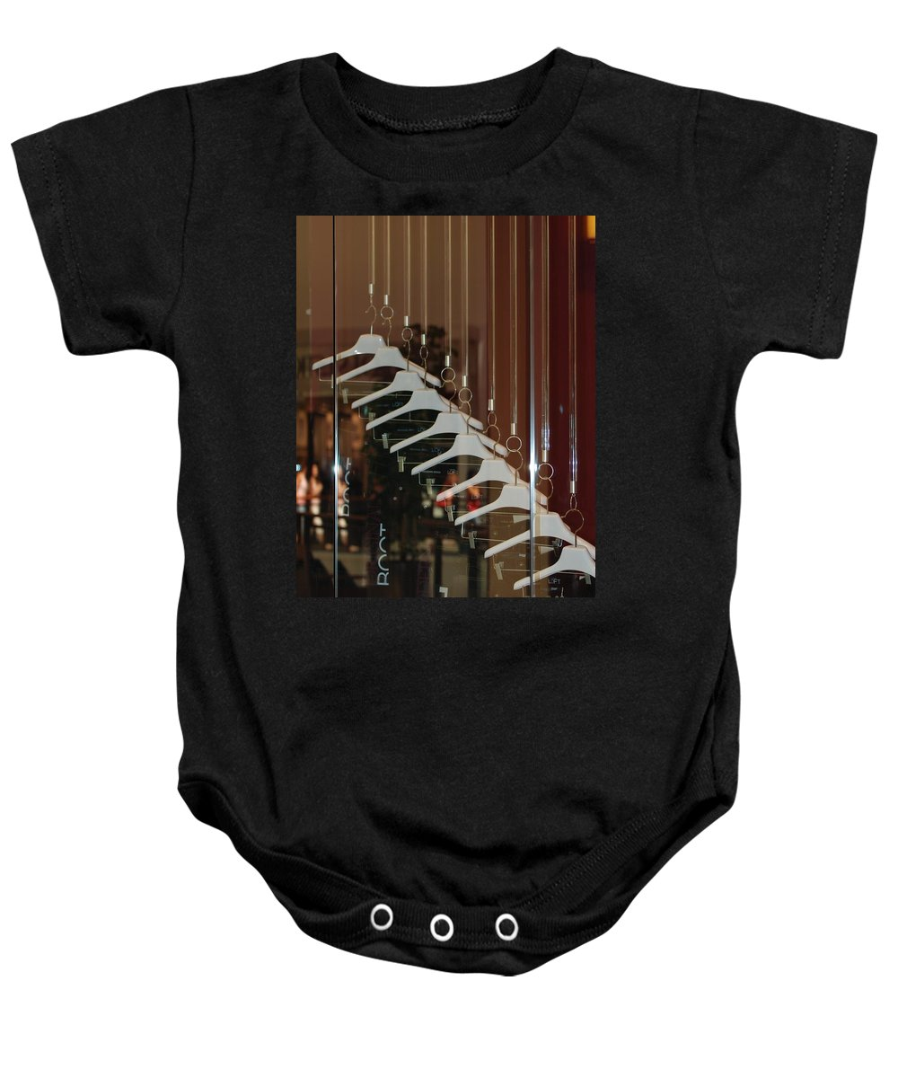 Hangers Baby Onesie featuring the photograph 10 Hangers by Rob Hans