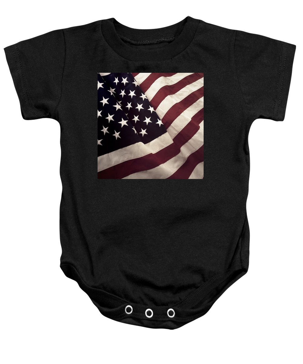 Closeup Baby Onesie featuring the photograph American Flag by Les Cunliffe