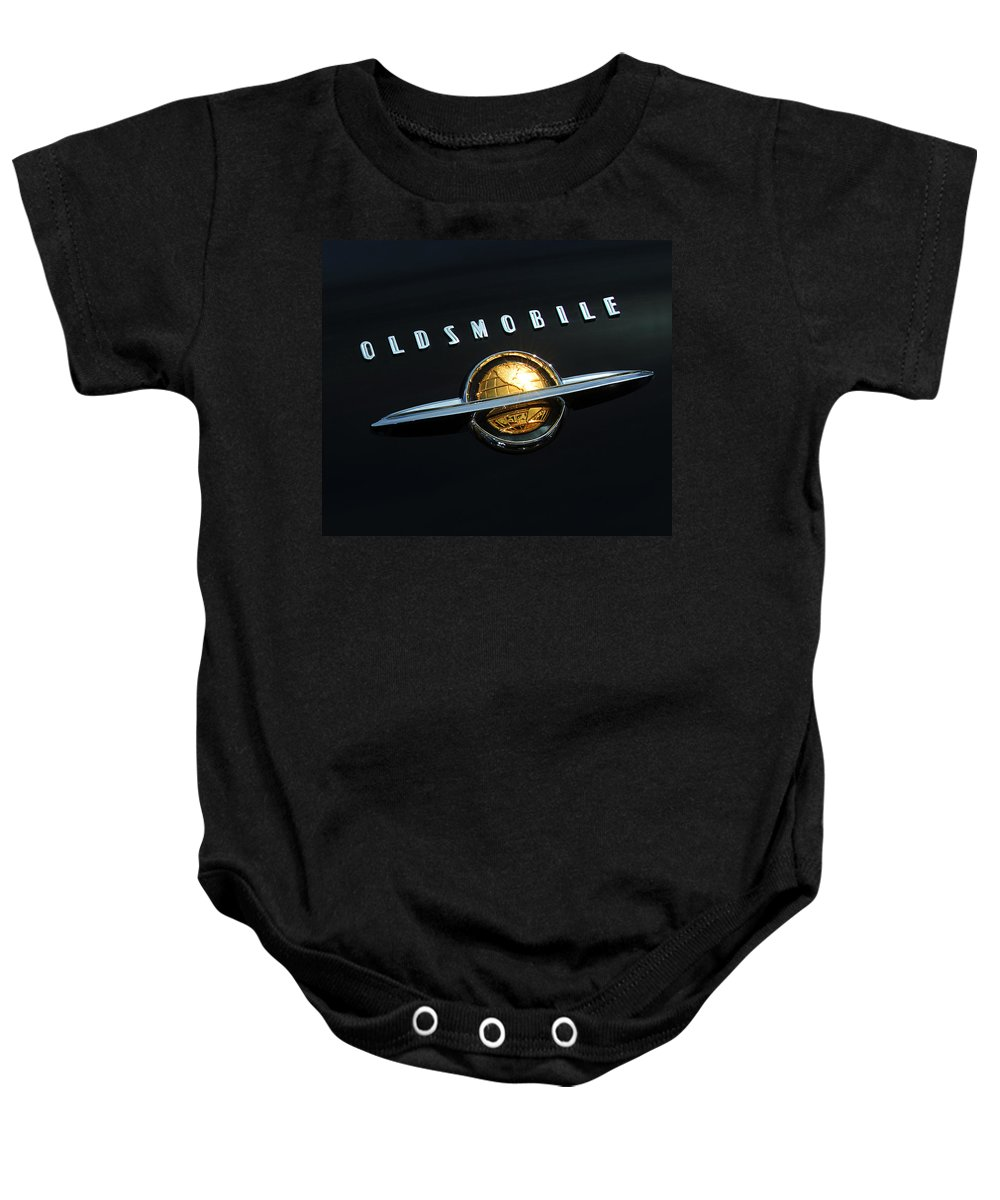 Car Baby Onesie featuring the photograph 1950 Oldsmobile Rocket 88 Convertible Emblem by Jill Reger