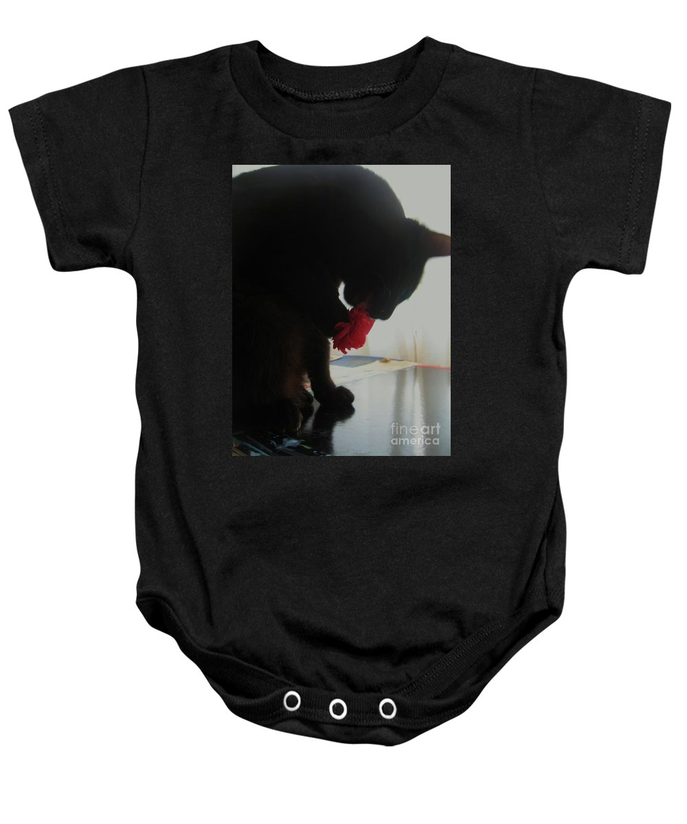 Photograph Cat Black Red Flower Camellia Baby Onesie featuring the photograph Cat Eating Camellia by Seon-Jeong Kim
