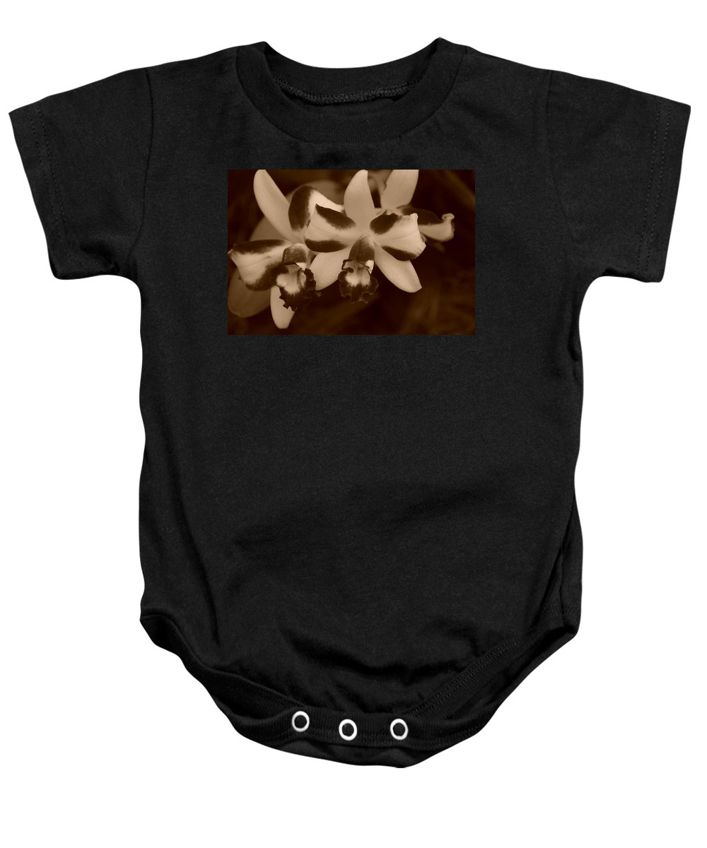 Macro Baby Onesie featuring the photograph Double Orchid by Rob Hans