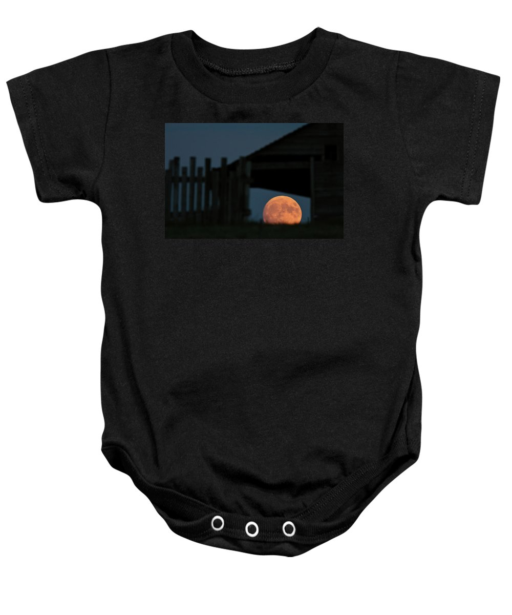 Full Moon Baby Onesie featuring the digital art Full Moon Seen Through Old Building Window by Mark Duffy