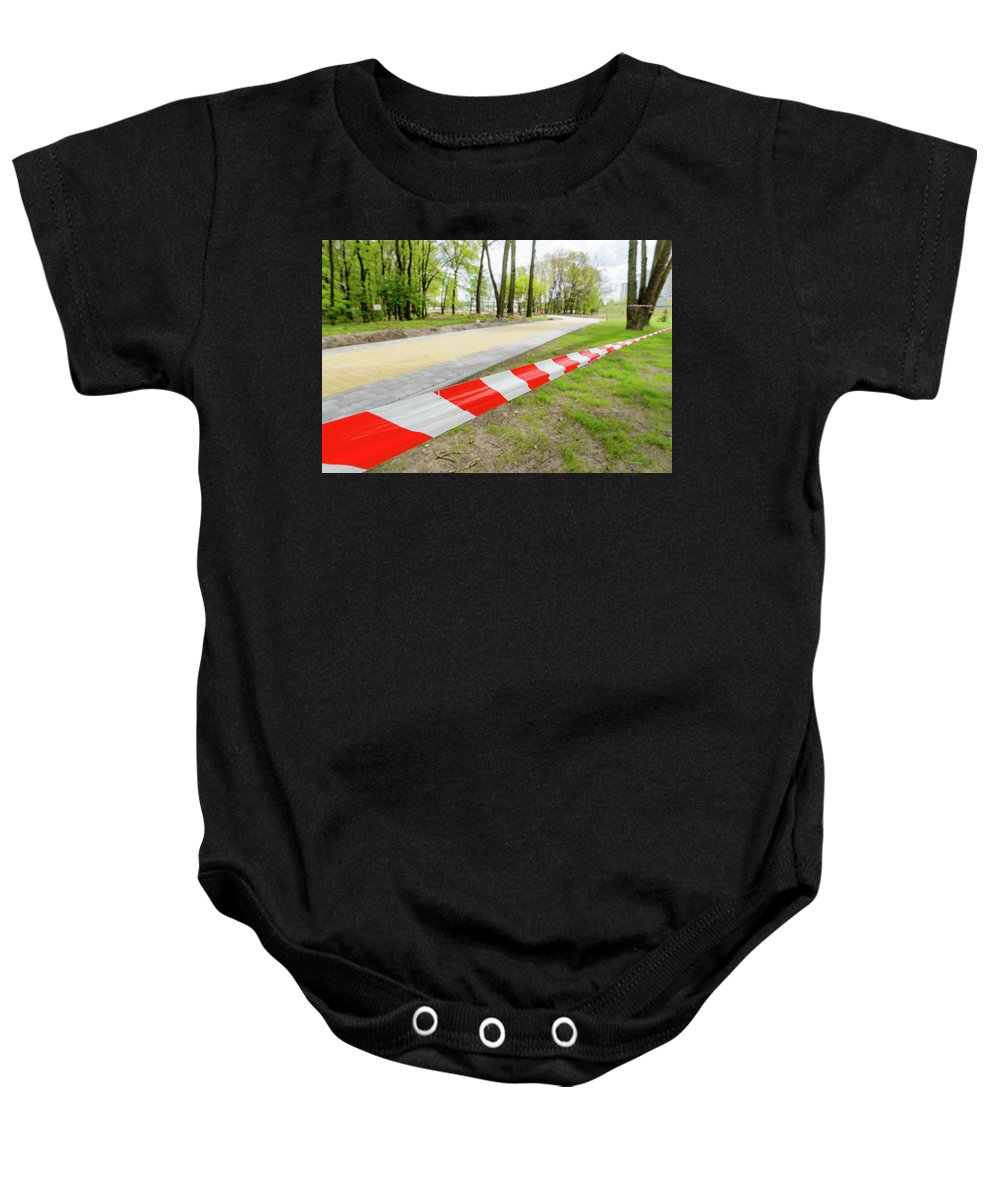 Area Baby Onesie featuring the photograph Red And White Barricade Tape by Alain De Maximy