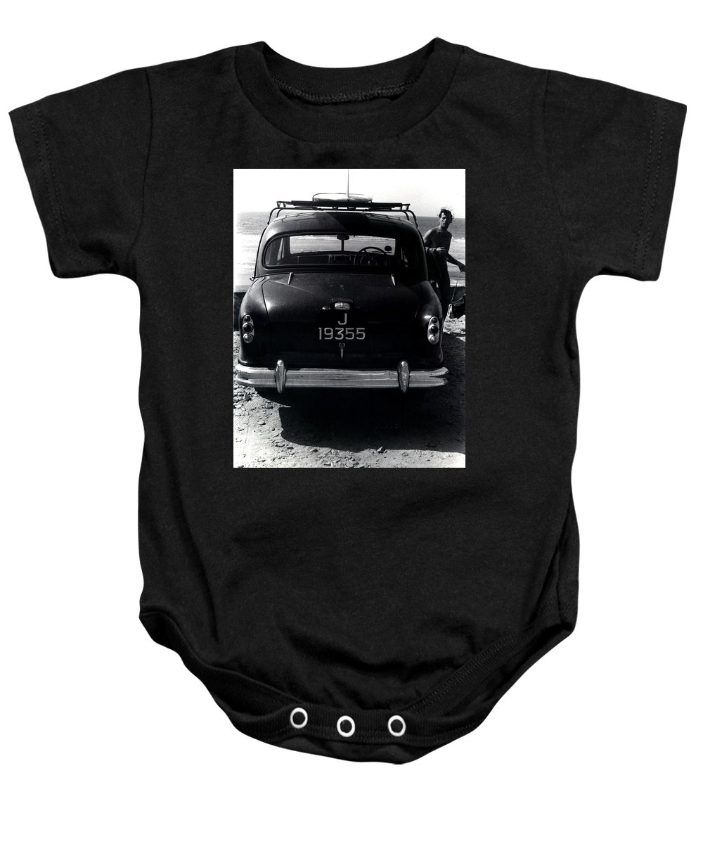Surf Baby Onesie featuring the photograph 50's Surfer by Charles Stuart