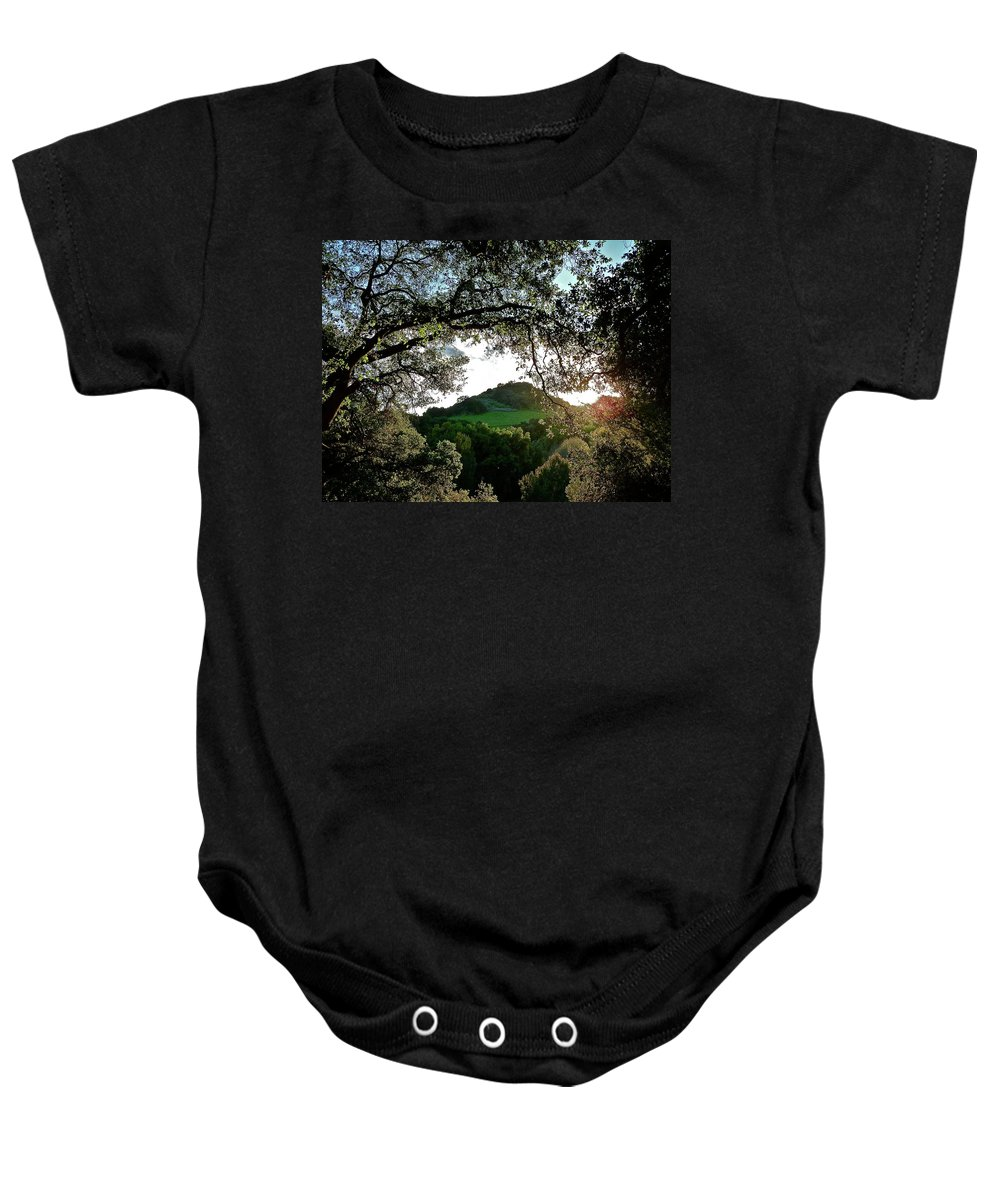 Landscape Baby Onesie featuring the photograph A Distant Cross by Diana Hatcher