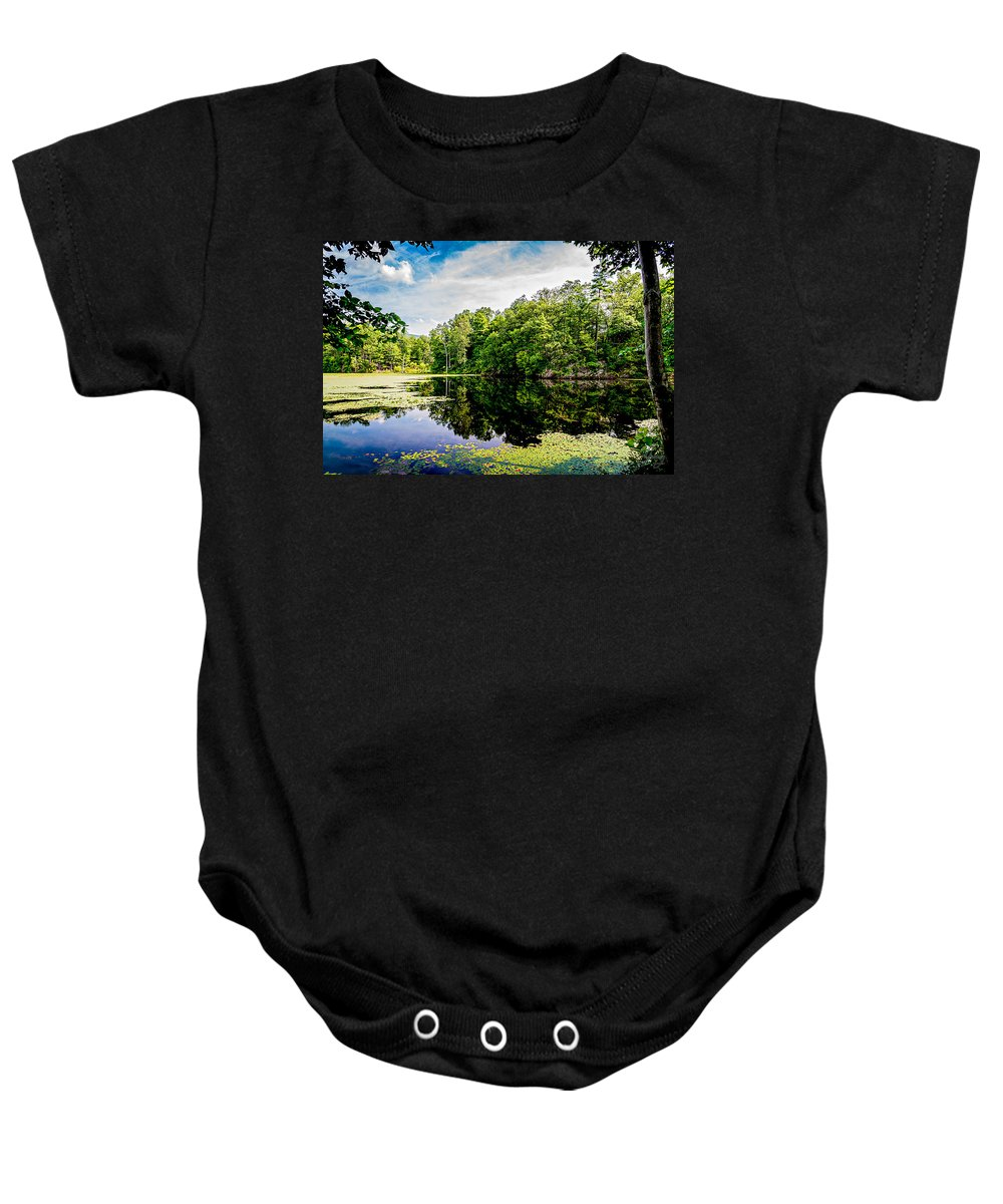 Algae Baby Onesie featuring the photograph A Reflected Forest On A Lake With Lily Pads by Joshua Zaring