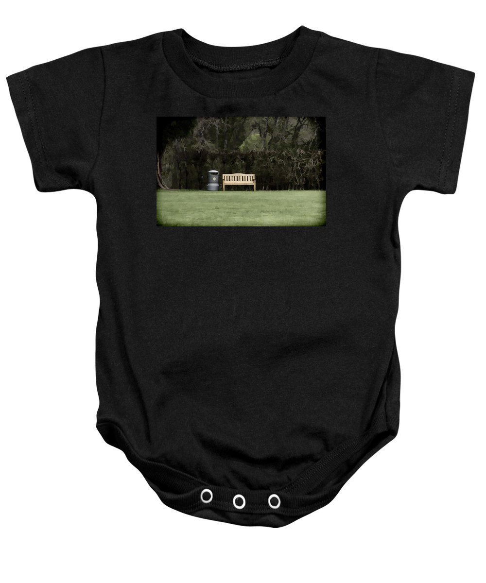 Bench Baby Onesie featuring the photograph A Trash Can And Wooden Benches In A Small Grassy Area by Ashish Agarwal