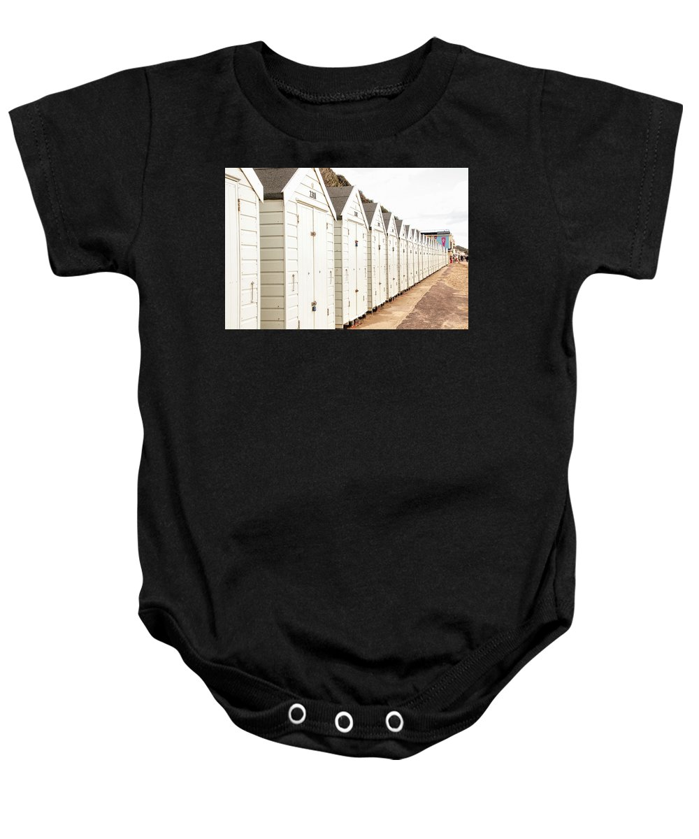 All In A Row Baby Onesie featuring the photograph All In A Row by Phyllis Taylor