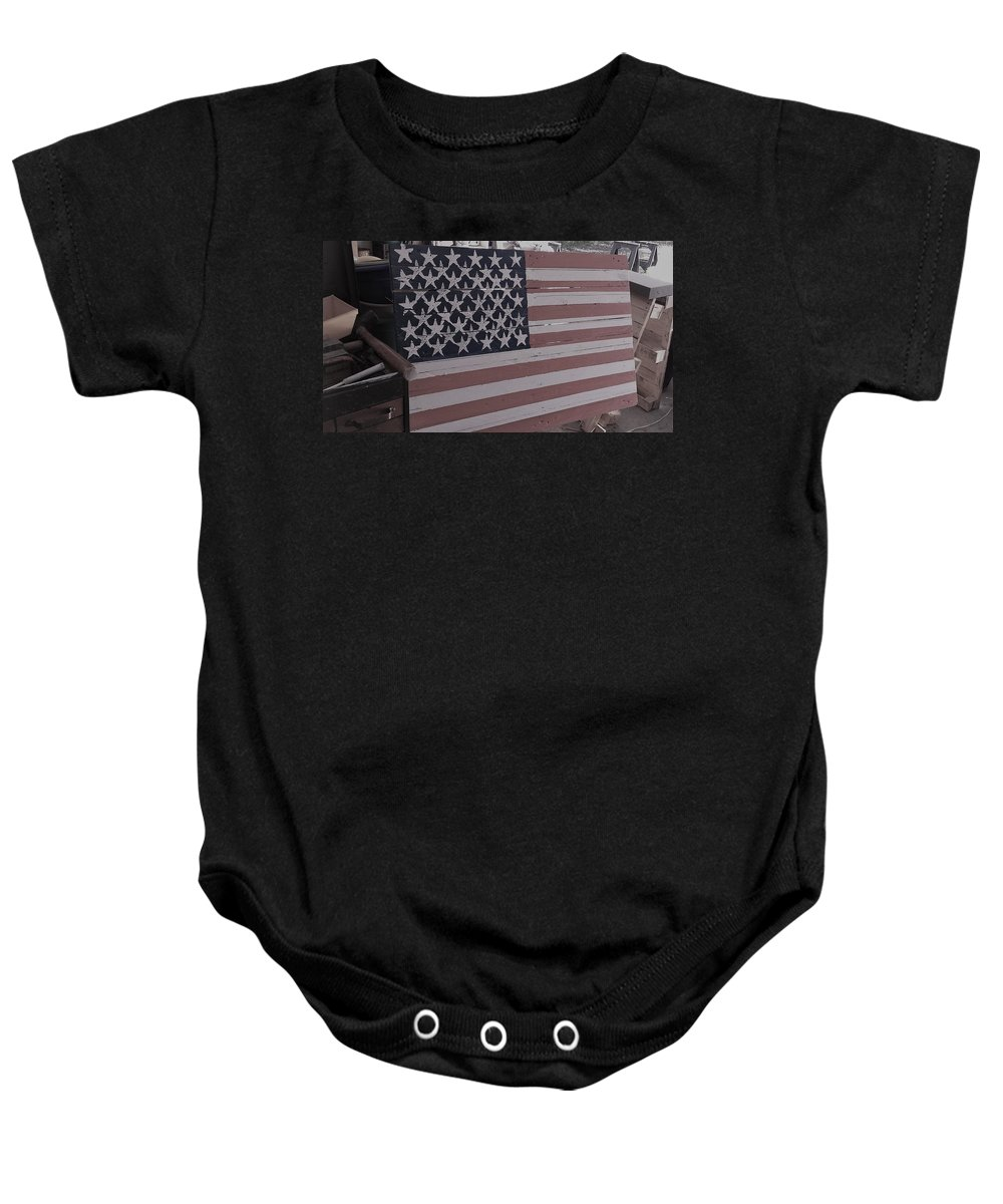 American Flag Shop Wood Working Handmade Pallet Art Baby Onesie featuring the photograph American Flag Shop by Lee Barrett