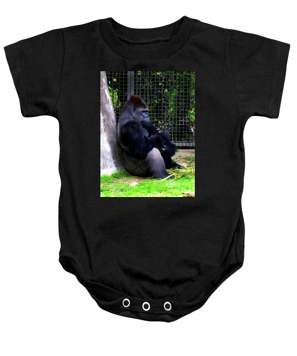 Ape Baby Onesie featuring the photograph And They Have Me In A Cage by Frances Hattier