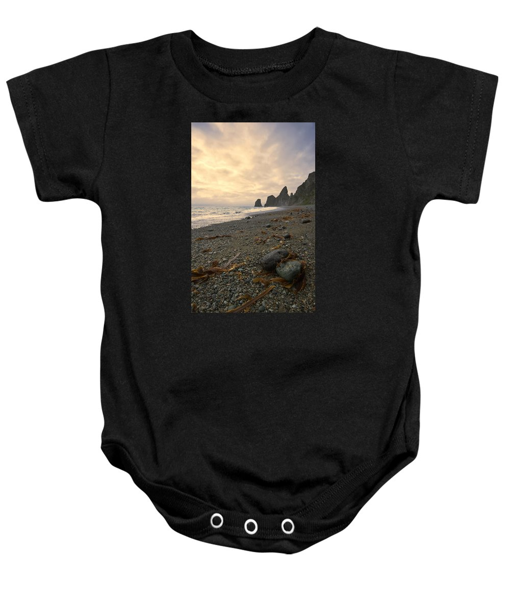 Adventure Baby Onesie featuring the photograph Anxiety Morning On The Ocean Shore. by Vladimir Serebryanskiy