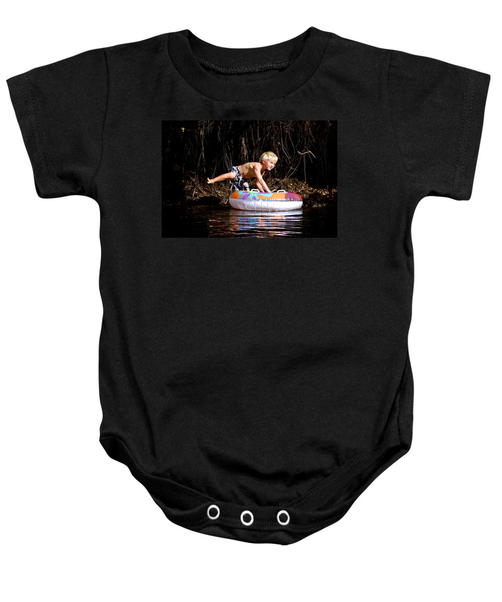 Austin Baby Onesie featuring the photograph Austin Takes A Ride by Eric Tressler