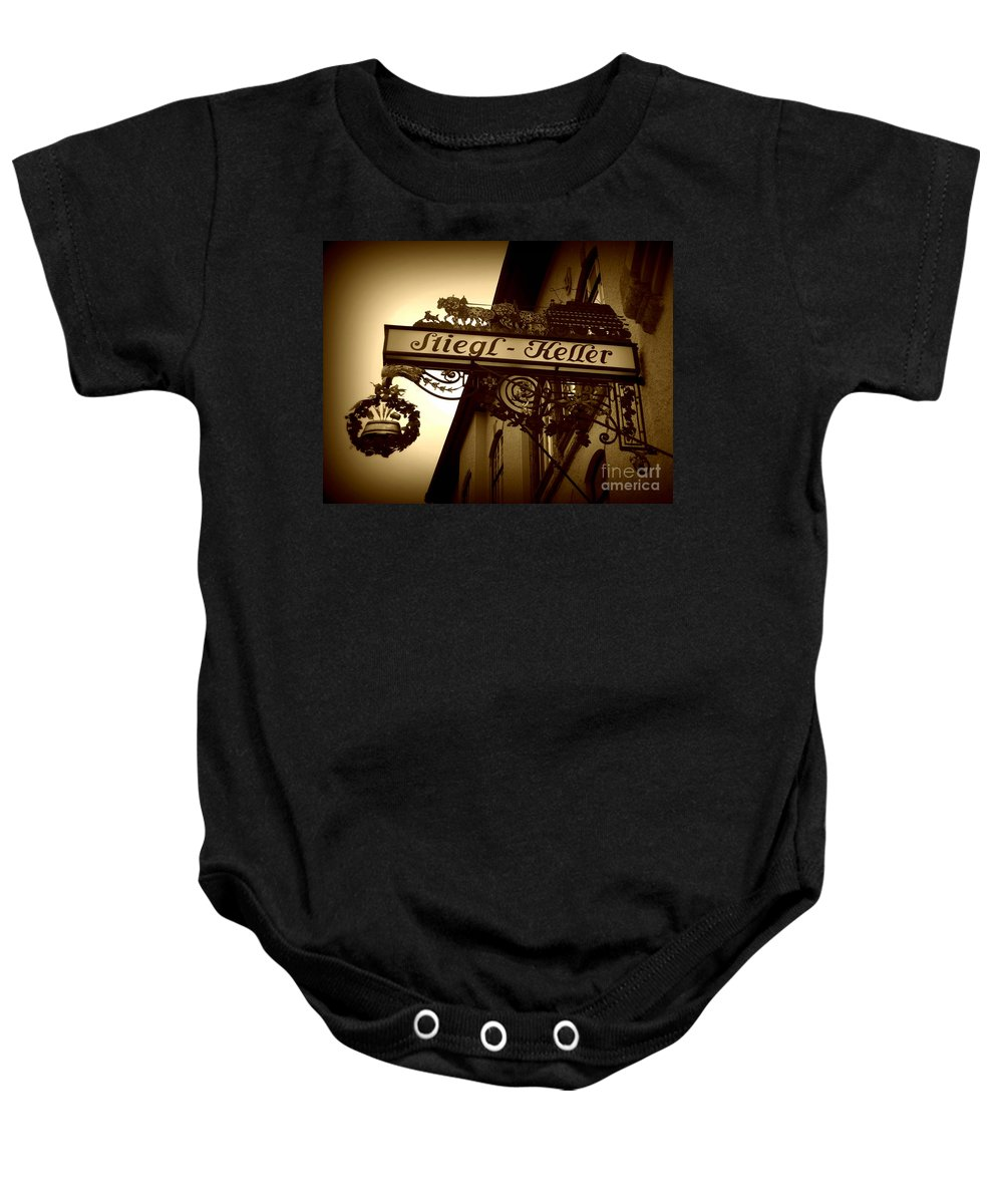 Sign Baby Onesie featuring the photograph Austrian Beer Cellar Sign by Carol Groenen