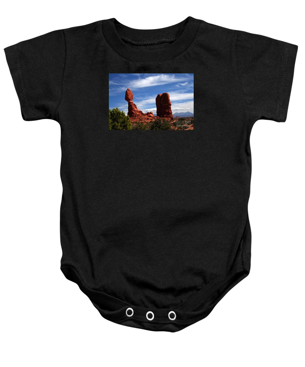 Balanced Rock Baby Onesie featuring the painting Balanced Rock Arches National Park, Moab, Utah by Corey Ford