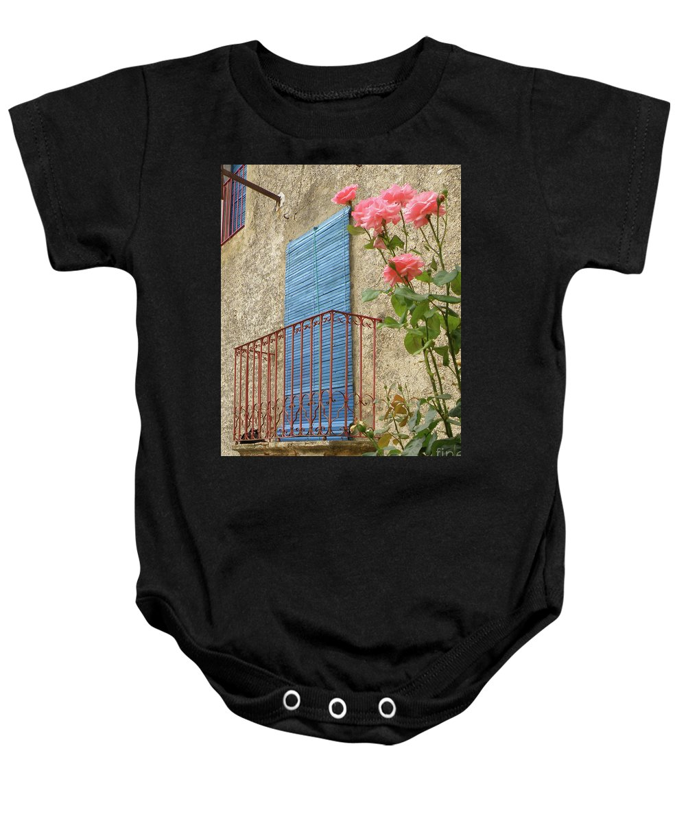 Balcony Baby Onesie featuring the photograph Balcony And Roses by Santi Goma Rodriguez