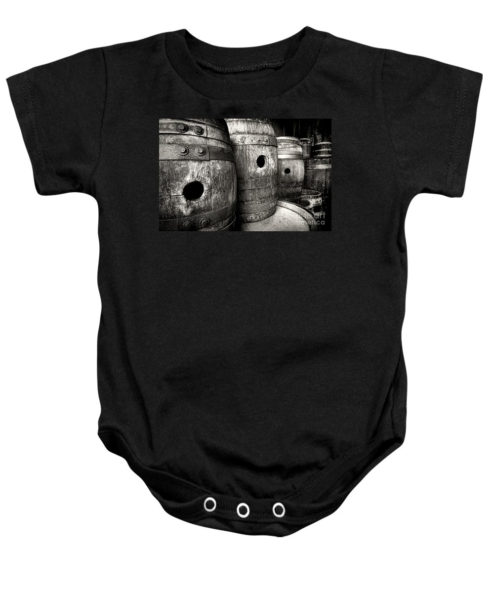 Barrel Baby Onesie featuring the photograph Barrels Of Laugh Past by Olivier Le Queinec